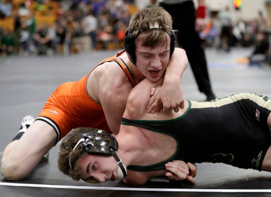 Kaukauna's Brandon Micksch, seen here wrestling Freedom's Koy Murphy on Jan. 4 at the Cheesehead Invitational, became a four-time Fox Valley Association champion Saturday at the conference meet in Fond du Lac.