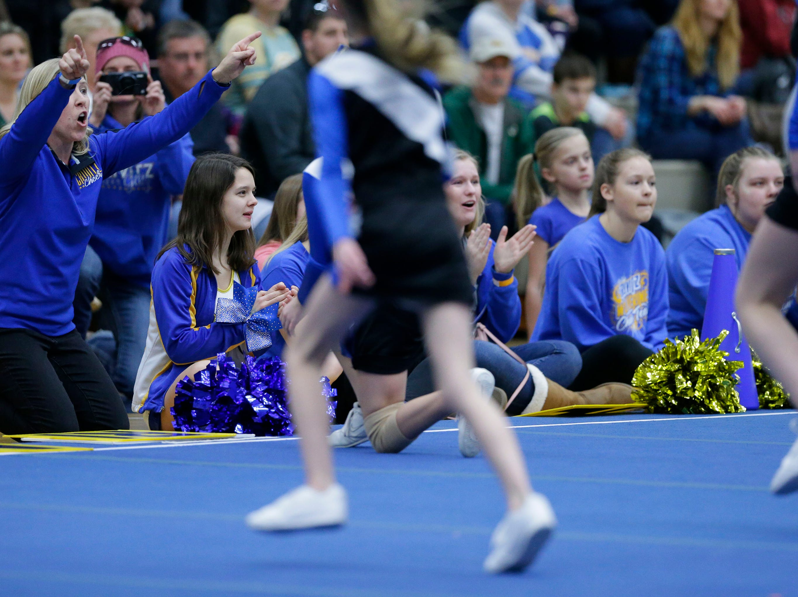 A Crivitz team gets coaching and cheering from the sidelines as the Lightning Bolt Explosion Cheer and Dance competition takes place Saturday, January 5, 2019, at Appleton North High School in Appleton, Wis.