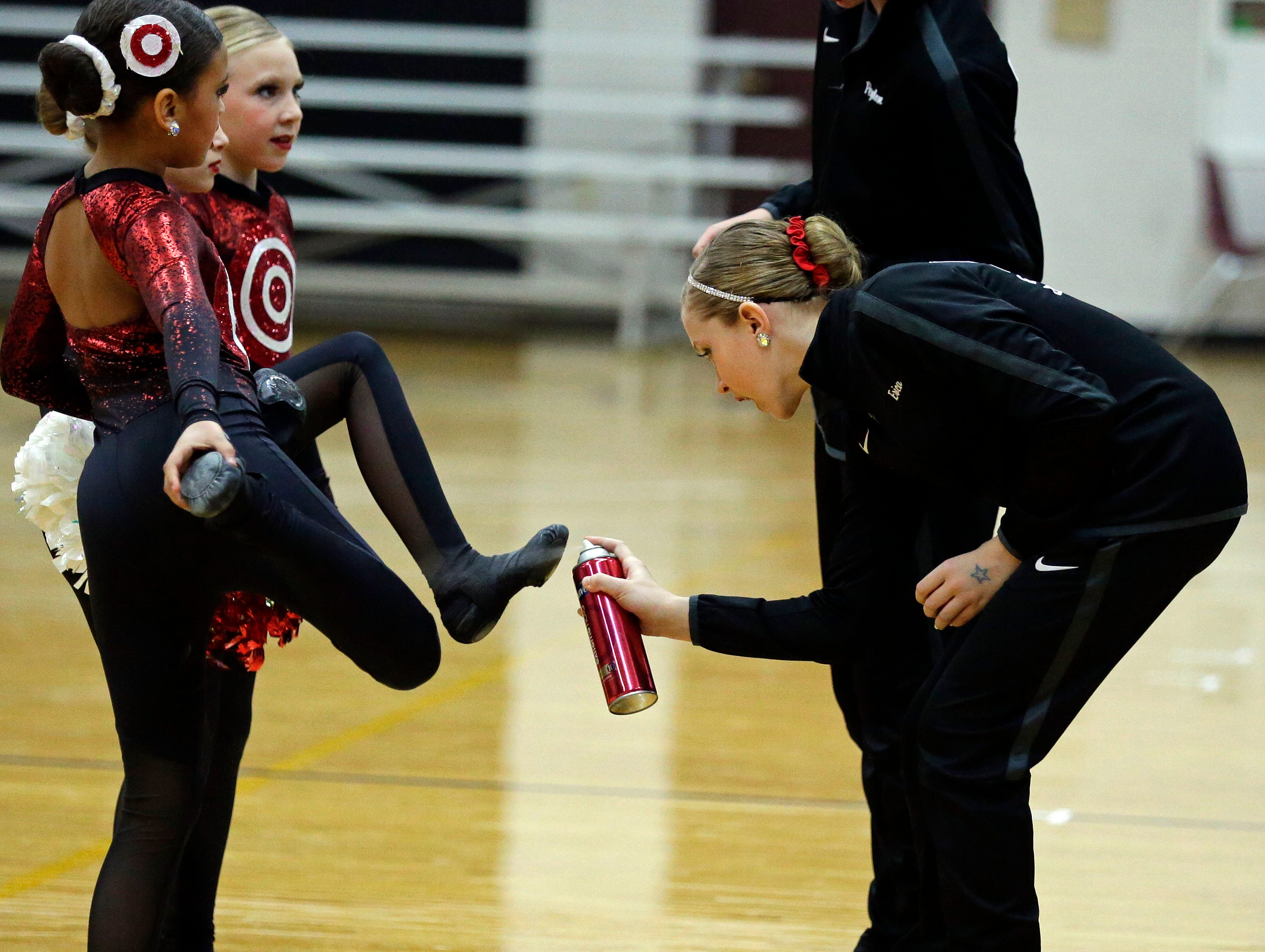 Hairspray helps competitors from sliding as the Lightning Bolt Explosion Cheer and Dance competition takes place Saturday, January 5, 2019, at Appleton North High School in Appleton, Wis.