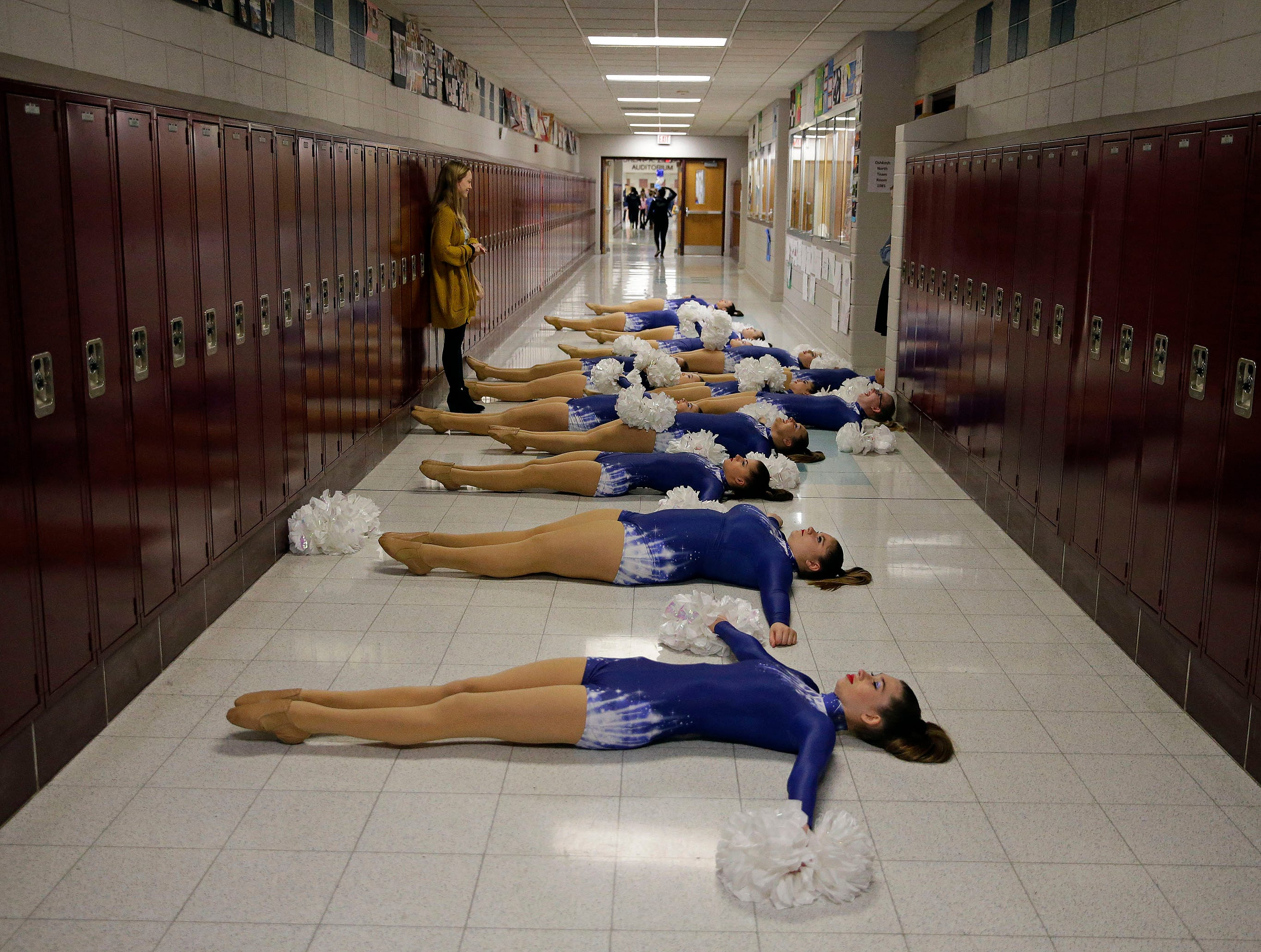 Howards Grove uses a hallway to warm-up before competing in the Varsity Pom Division as the Lightning Bolt Explosion Cheer and Dance competition takes place Saturday, January 5, 2019, at Appleton North High School in Appleton, Wis.