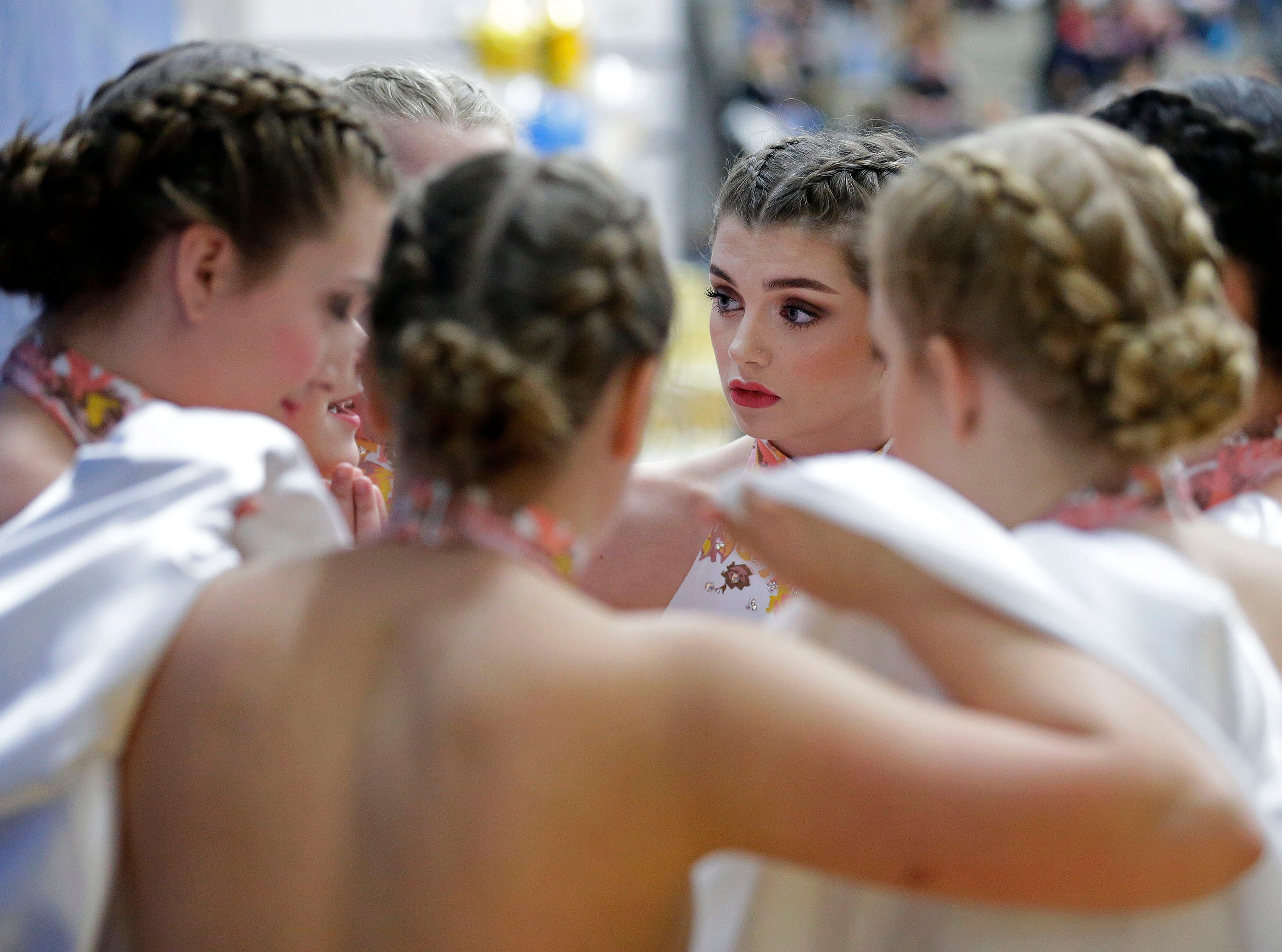 The Oconto Falls team gets ready to compete in the Varsity Jazz Division as the Lightning Bolt Explosion Cheer and Dance competition takes place Saturday, January 5, 2019, at Appleton North High School in Appleton, Wis.