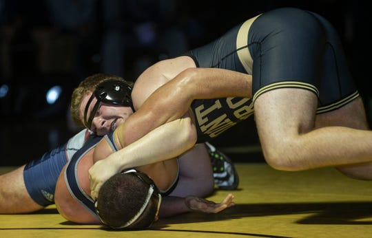 Point Pleasant Boro's Billy Borowsky works for the pin in his 220-pound bout against Lacey's Vincent Ceglie Friday night. Point Boro won the match 33-29