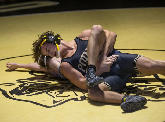 Point Plesant Boro's Jack Bailey pinned Lacey's Zach Higgins with a Peterson in the 145-pound bout Friday night. Point Boro won the match 33-29.