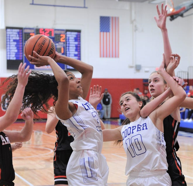 Cooper's Keiana Kemp, left, shoots as teammate Brianna Garcia (10) and Aledo's Maddie Shumway look on. Aledo beat the Lady Cougars 62-26 in the District 4-5A opener Friday, Jan. 4, 2019, at Cougar Gym.