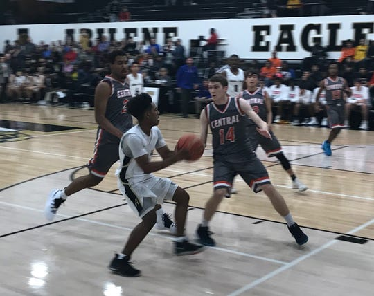 Jalen McGee drives into two defenders during Abilene High's District 3-6A game against San Angelo Central Jan. 4, 2019.