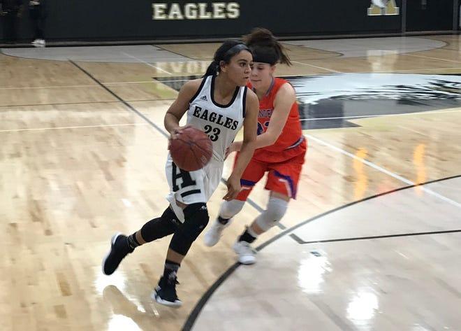 Alyssa Washington drives baseline against San Angelo Central during the first quarter in Eagle Gym Jan. 4, 2019.
