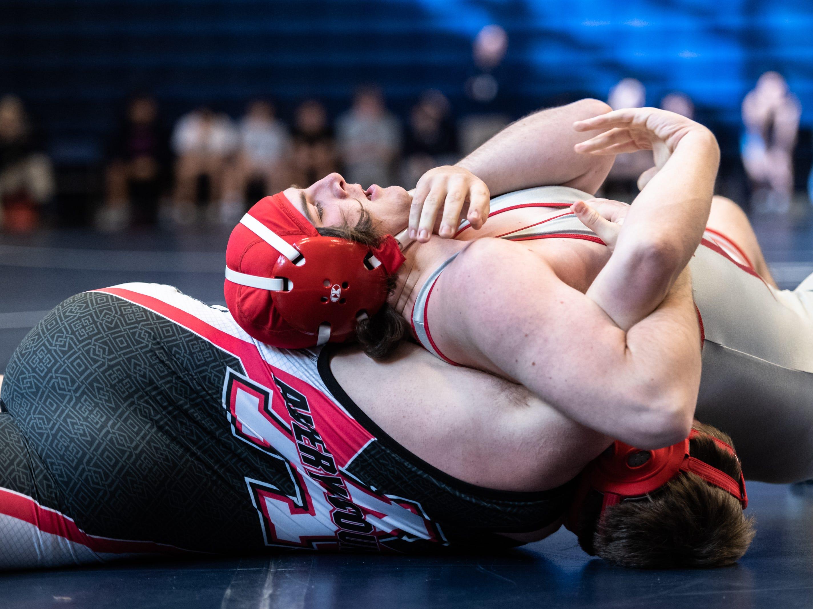 Hendersonville's Austin Hudson wrestles Avery County's Dakota Hudson during Eblen Charities' Headlock on Hunger wrestling tournament at Enka High School Jan. 5, 2018.