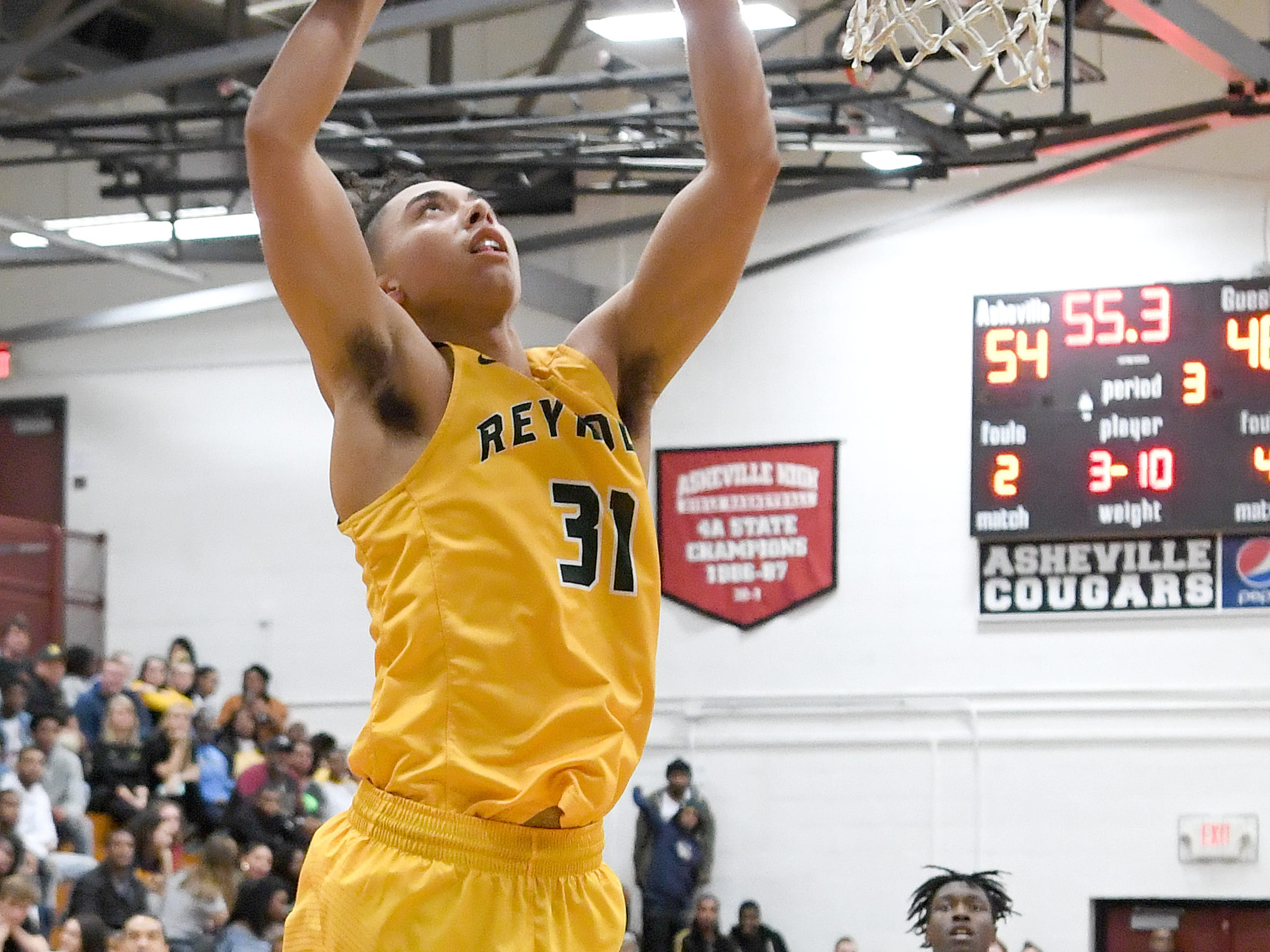 Reynolds' Jeremiah Dorsey makes a shot during the Rockets' game at Asheville High School on Jan. 4, 2019. The Cougars defeated the Rockets 78-70.