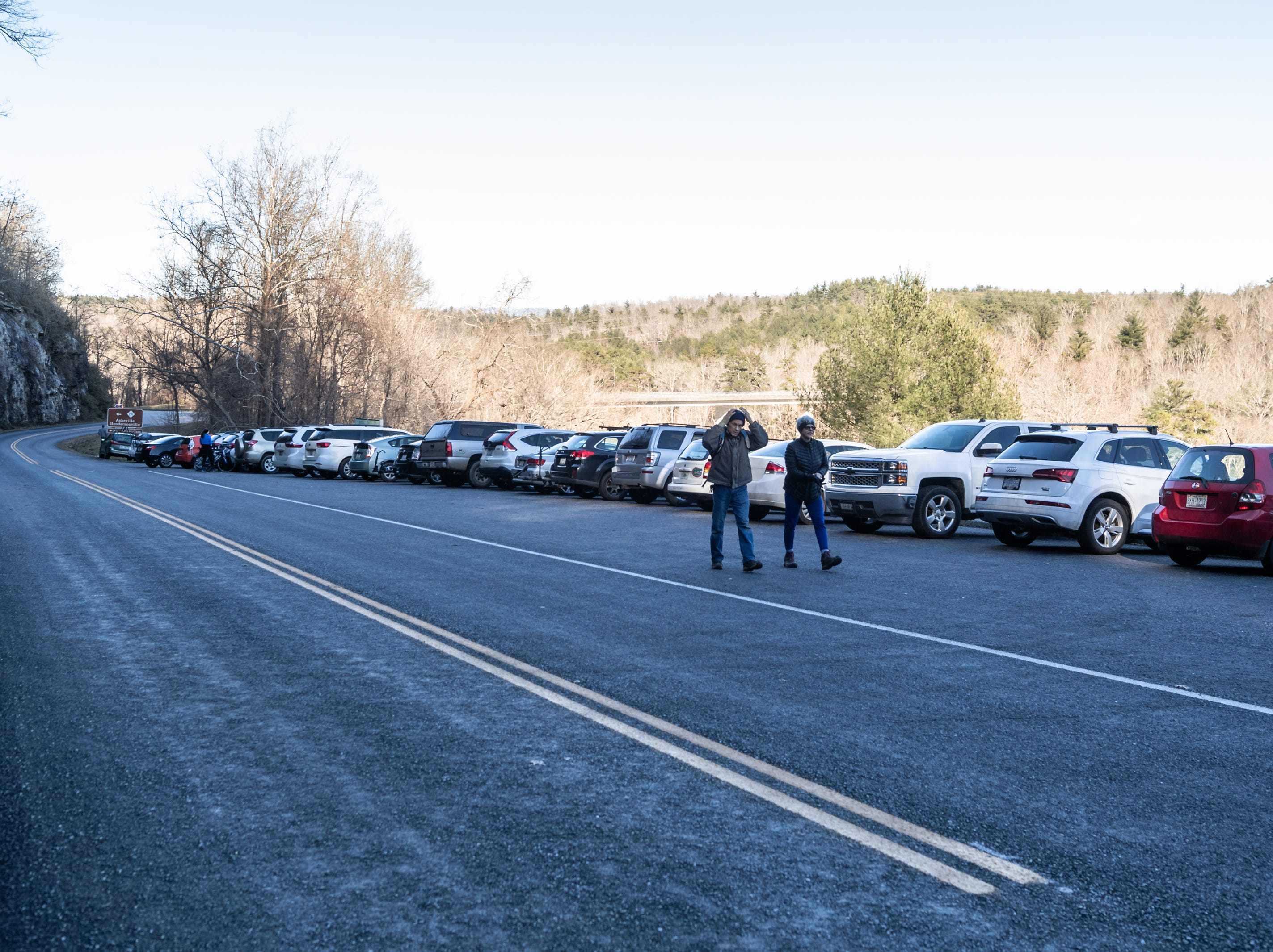 Vehicles fill a parking area at the beginning of the southern section of the Blue Ridge Parkway just south of the North Carolina Arboretum Jan. 5, 2019. Much of the Parkway has been closed due to the government shut down.