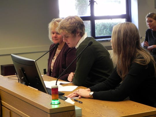 Jon Tammen, center, testifies in favor of the Uniform Parentage Act while in Olympia. The law, which went into effect Jan. 1, allows surrogate mothers to be paid for carrying a baby for another couple.
