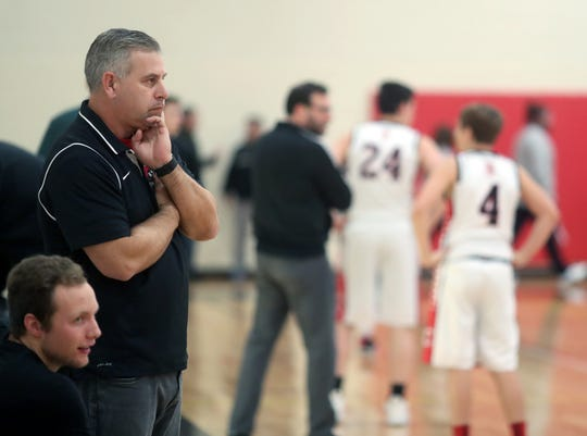 Derrin Doty ponders his Crosspoint boys basketball team's nonleague game against Klahowya on Dec. 4.