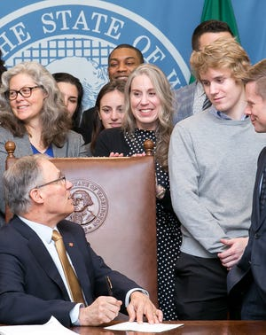 Gov. Inslee signs Engrossed Substitute Senate Bill No. 6037, March 6, 2018. Relating to the uniform parentage act.