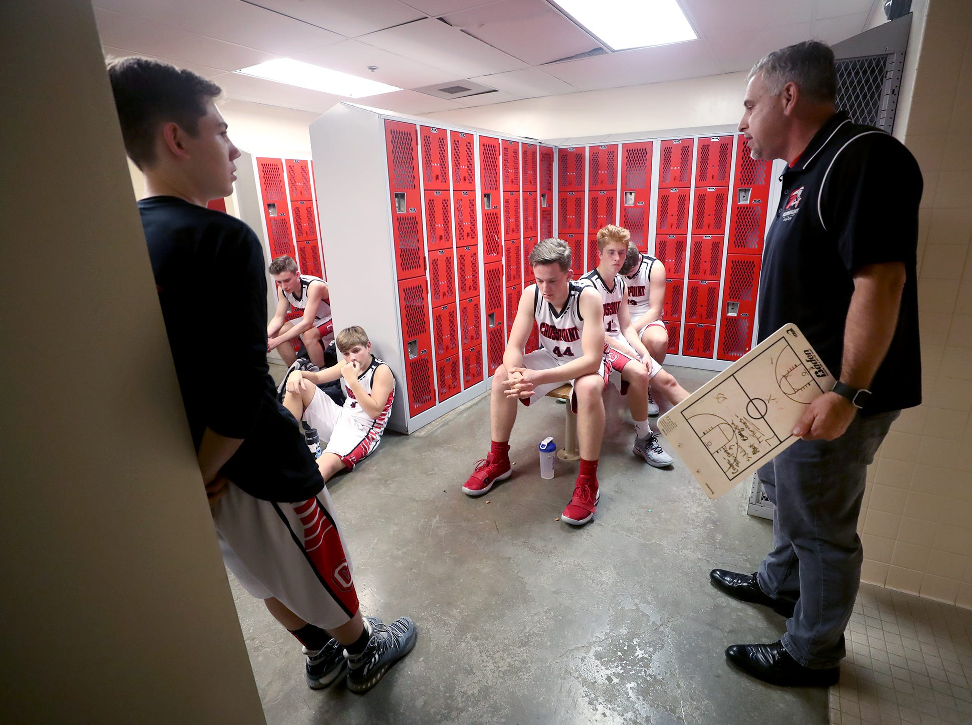 The Crosspoint boys basketball team played Klahowya at Crosspoint on Friday, December, 4, 2019. Crosspoint new varsity coach Derrin Doty gives the team a halftime pep talk after they fell behind in the game.