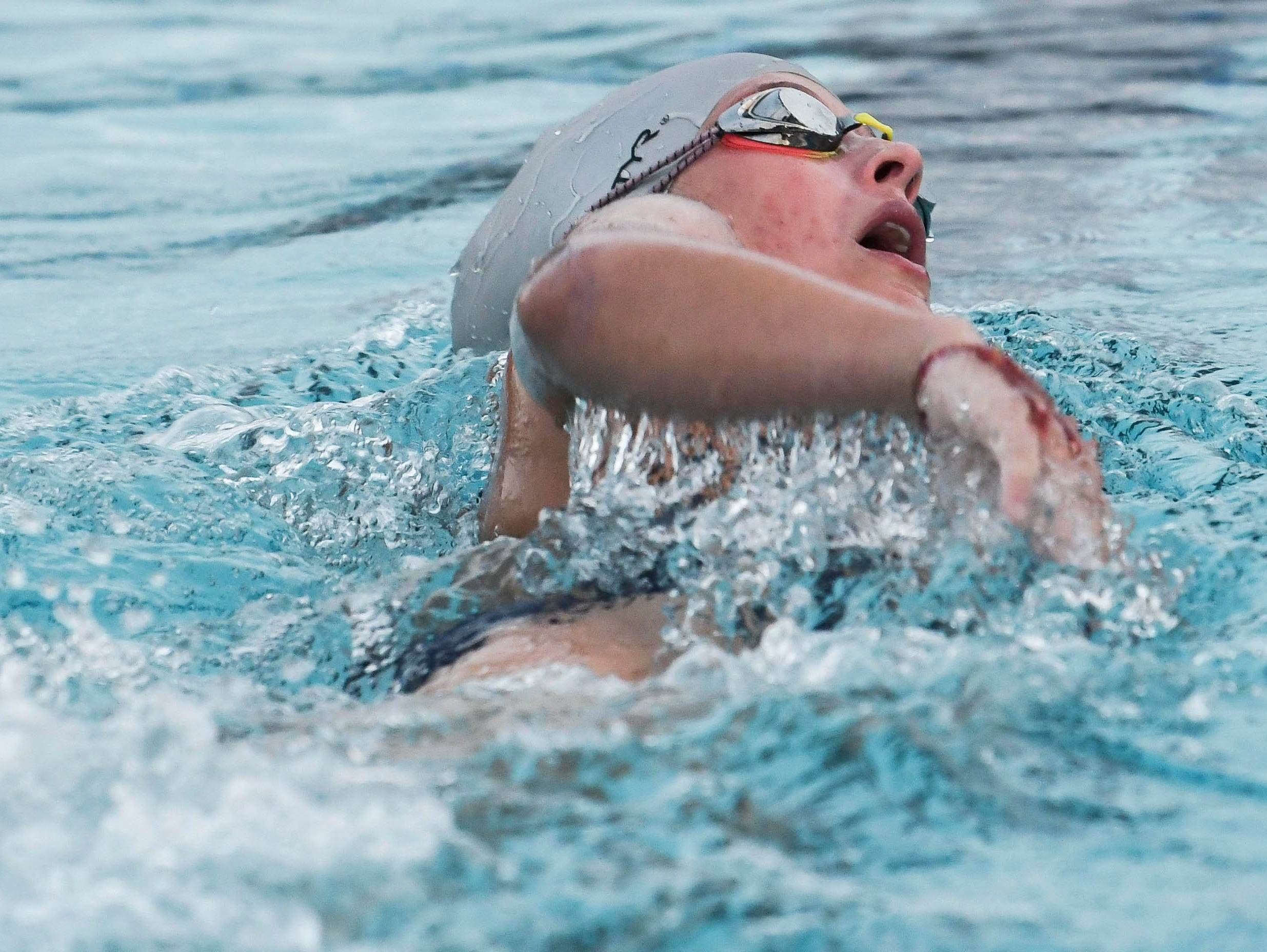 Madison Reilly swims as part of her tryout for ocean lifeguard at Rockledge High School early Saturday morning.