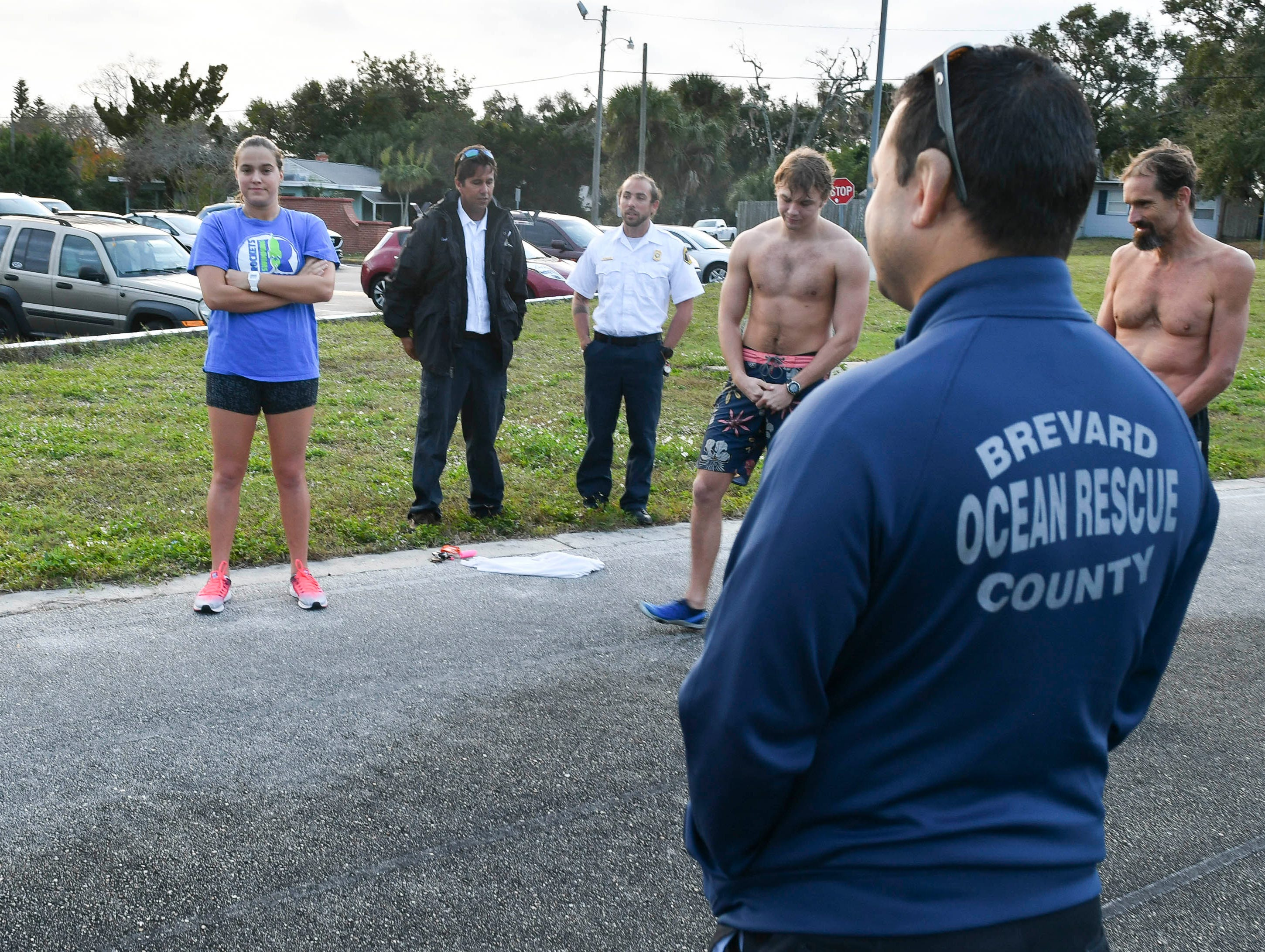 Eisen Witcher, Brevard County Ocean Rescue Chief speaks with applicants for ocean lifeguard positions prior to their physical evaluation at Rockledge High School early Saturday morning.
