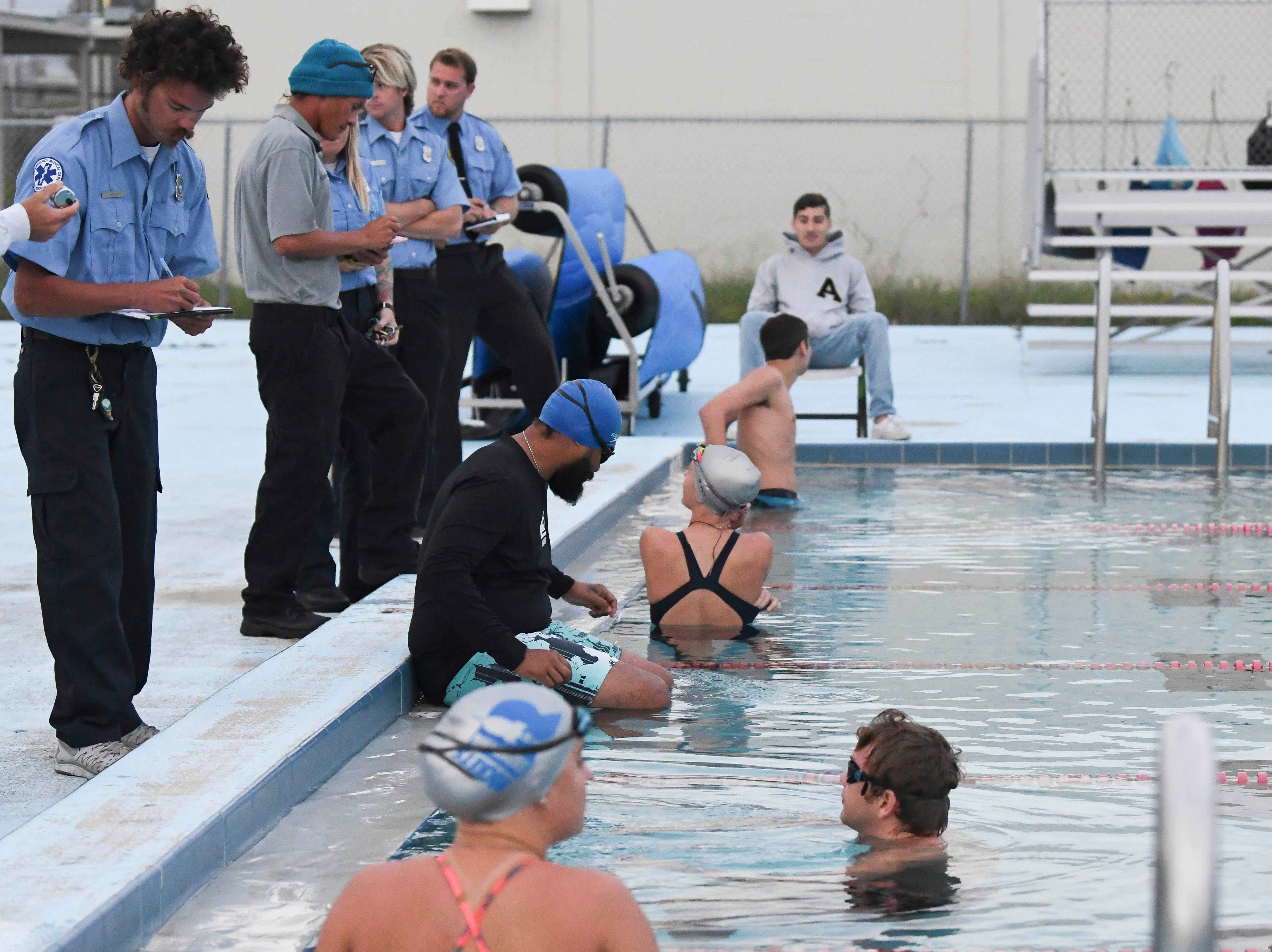 Applicants for ocean lifeguard positions with the county gather for their swim evaluation at Rockledge High School early Saturday morning.