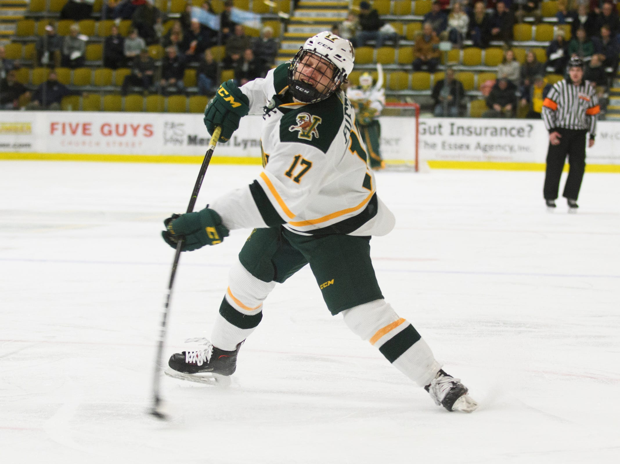 Vermont forward Craig Puffer (17) shoots the puck during the men's hockey game between the Sacred Heart Pioneers and the Vermont Catamounts at Gutterson Field House on Friday night January 4, 2019 in Burlington.