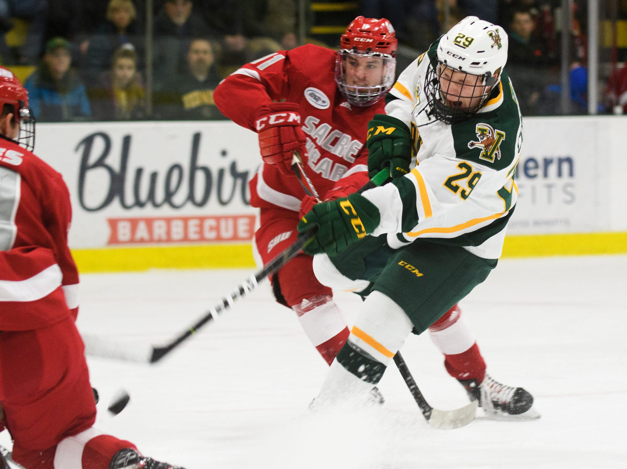 Vermont forward Dallas Comeau (29) shoots the puck during the men's hockey game between the Sacred Heart Pioneers and the Vermont Catamounts at Gutterson Field House on Friday night January 4, 2019 in Burlington.