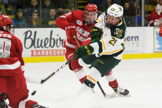 Vermont forward Dallas Comeau (29) shoots the puck during the men's hockey game between the Sacred Heart Pioneers and the Vermont Catamounts at Gutterson Fieldhouse on Friday night January 4, 2019 in Burlington.