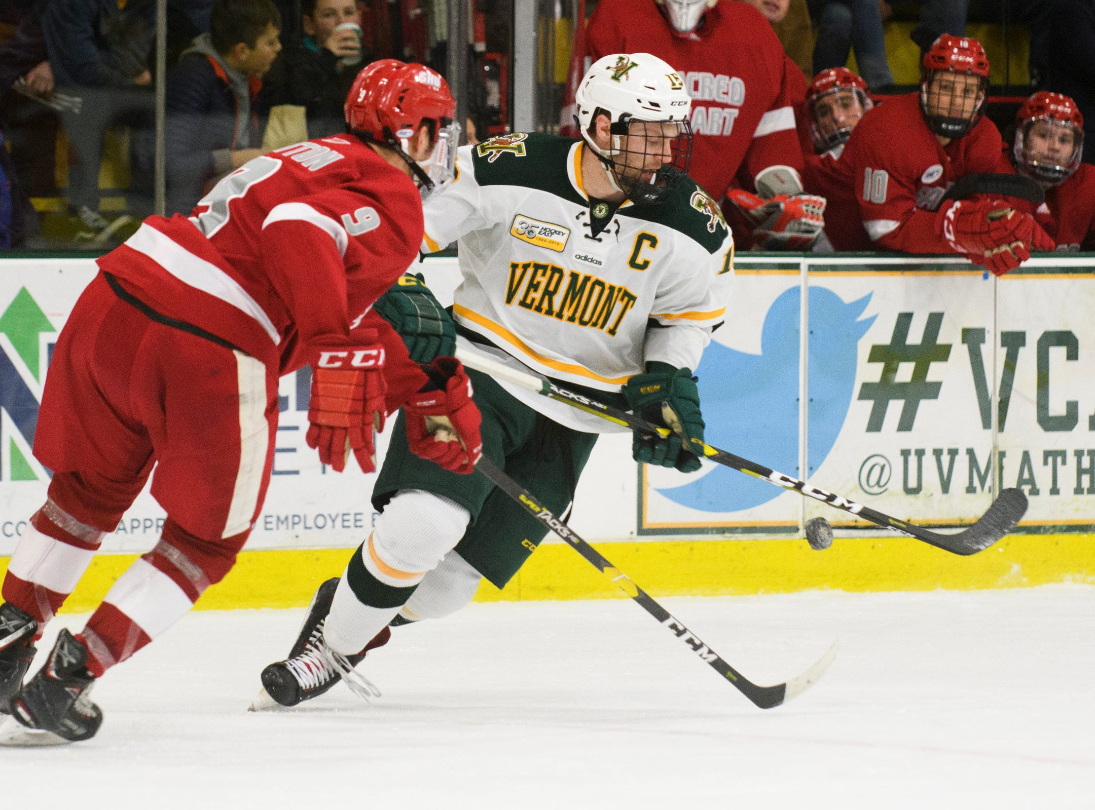 Vermont forward Derek Lodermeier (16) skates with the puck during the men's hockey game between the Sacred Heart Pioneers and the Vermont Catamounts at Gutterson Field House on Friday night January 4, 2019 in Burlington.