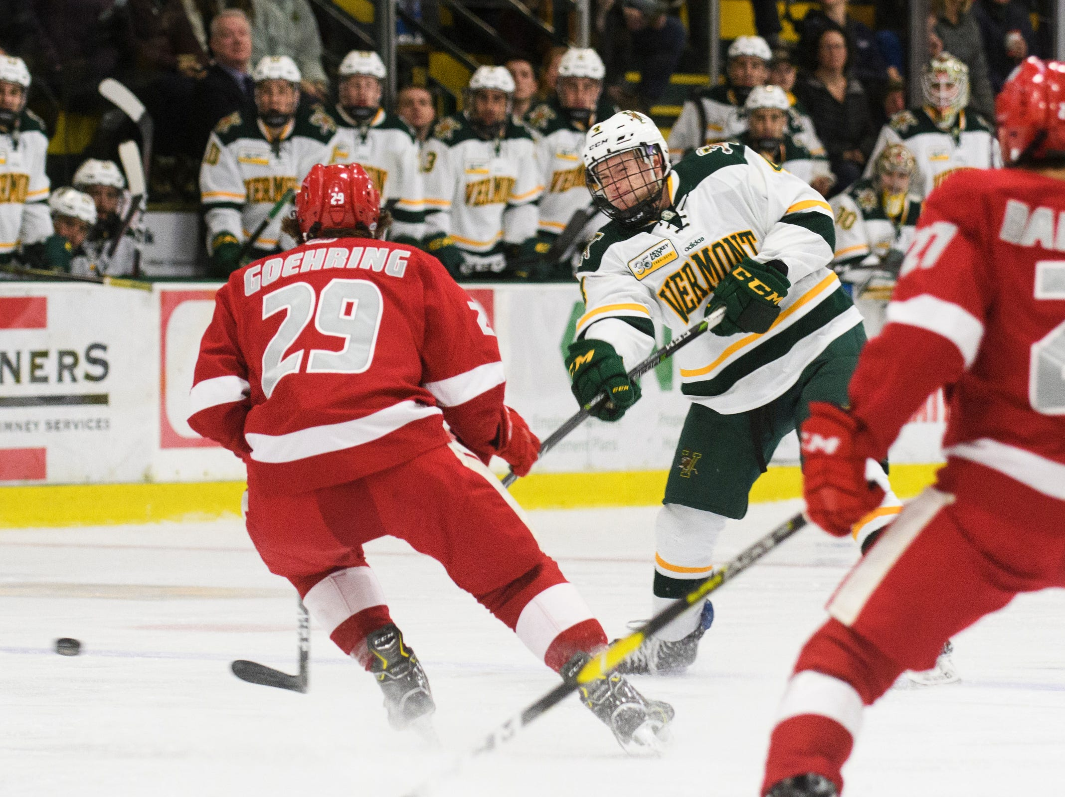 Vermont defenseman Owen Grant (4) shoots the puck during the men's hockey game between the Sacred Heart Pioneers and the Vermont Catamounts at Gutterson Field House on Friday night January 4, 2019 in Burlington.