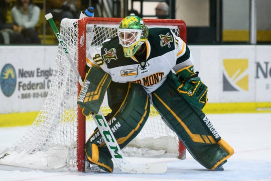 Vermont goalie Stefanos Lekkas (40) keeps an eye on the puck during the men's hockey game between the Sacred Heart Pioneers and the Vermont Catamounts at Gutterson Field House on Friday night January 4, 2019 in Burlington.