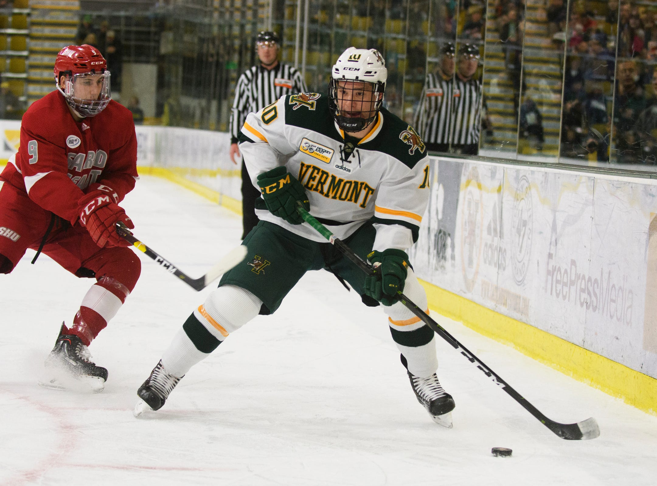 Vermont forward Vald Dzhioshvilli (10) looks to pass the puck during the men's hockey game between the Sacred Heart Pioneers and the Vermont Catamounts at Gutterson Field House on Friday night January 4, 2019 in Burlington.