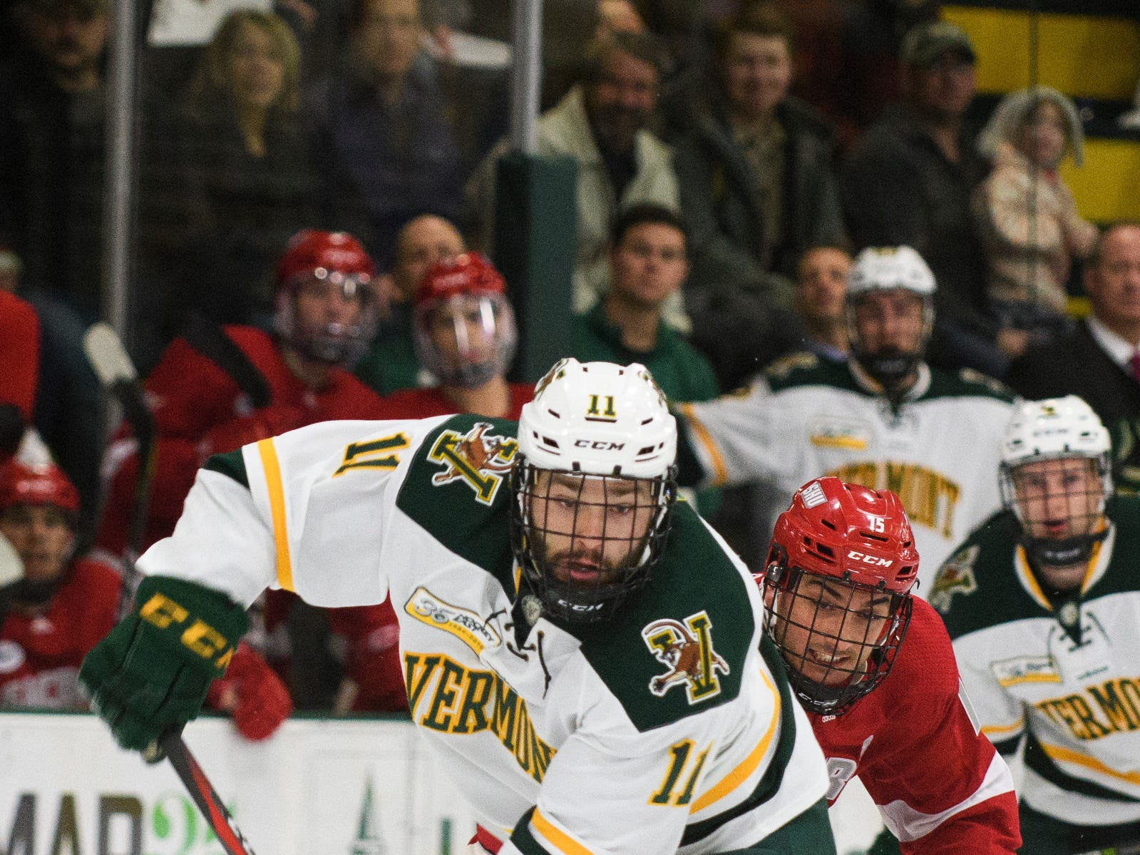 Vermont forward Conor O'Neil (11) skates with the puck during the men's hockey game between the Sacred Heart Pioneers and the Vermont Catamounts at Gutterson Field House on Friday night January 4, 2019 in Burlington.