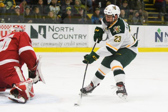 Vermont forward Max Kaufman (23) shoots the puck on a break away during the men's hockey game between the Sacred Heart Pioneers and the Vermont Catamounts at Gutterson Field House on Friday night January 4, 2019 in Burlington.