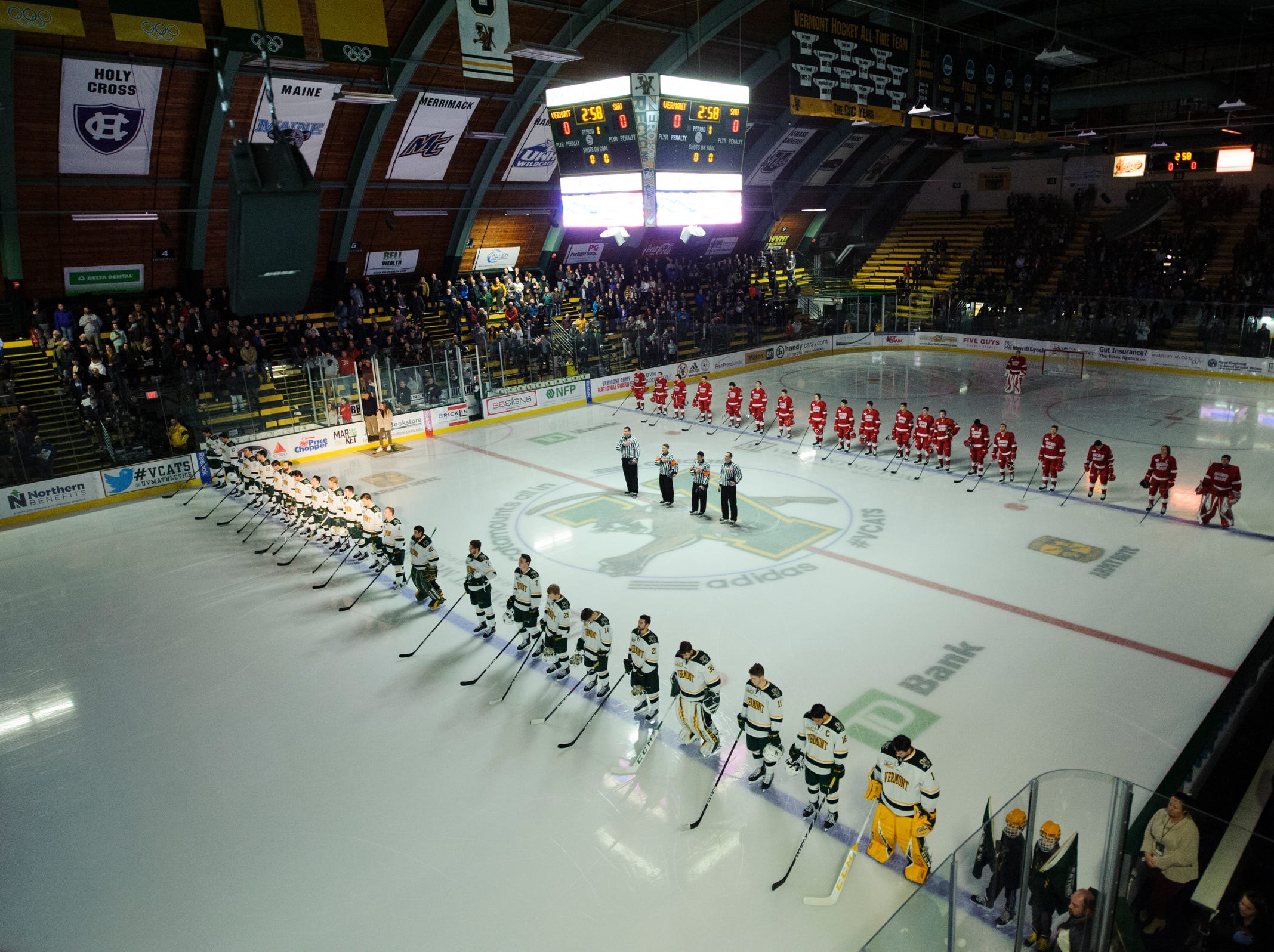 The teams listen to the National Anthem during the men's hockey game between the Sacred Heart Pioneers and the Vermont Catamounts at Gutterson Field House on Friday night January 4, 2019 in Burlington.