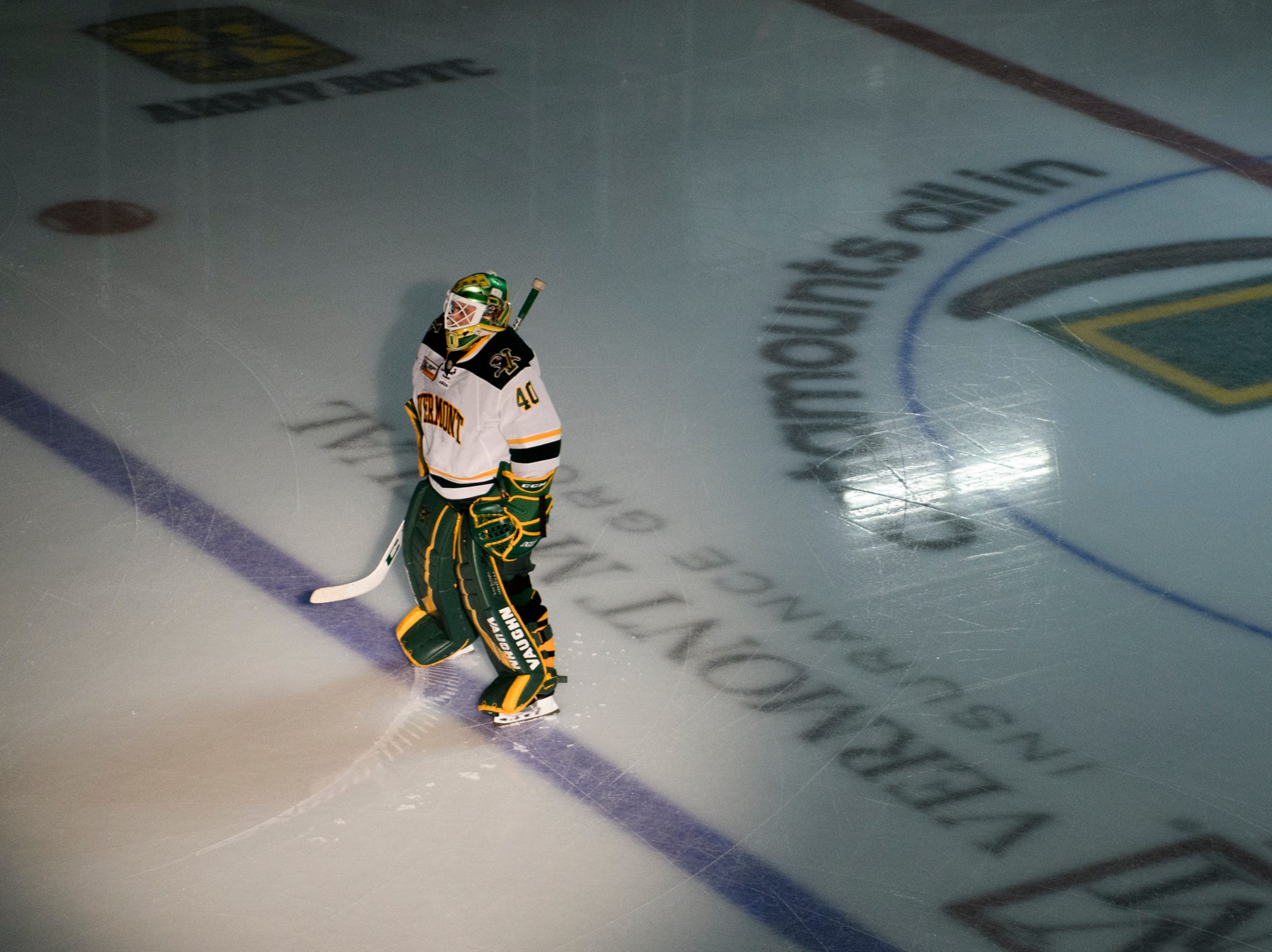 Vermont goalie Stefanos Lekkas (40) stands at the blue line during the player introductions before the start of the men's hockey game between the Sacred Heart Pioneers and the Vermont Catamounts at Gutterson Field House on Friday night January 4, 2019 in Burlington.