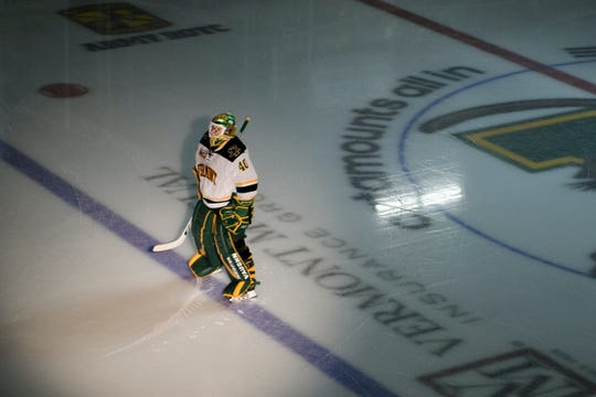 Vermont goalie Stefanos Lekkas (40) stands at the blue line during the player introductions before the start of the men's hockey game between the Sacred Heart Pioneers and the Vermont Catamounts at Gutterson Fieldhouse last season.