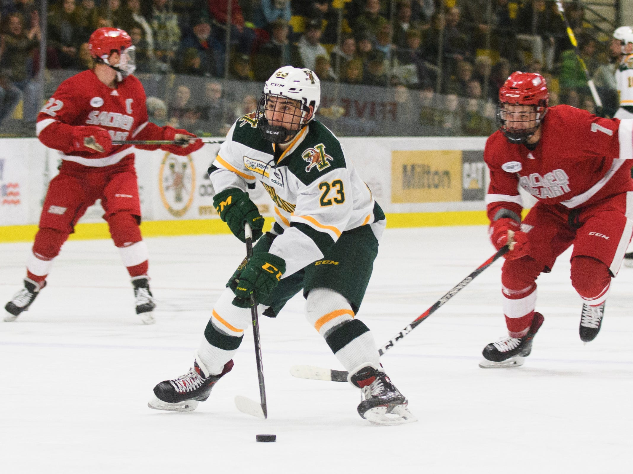 Vermont forward Max Kaufman (23) looks to shoot the puck on a break away during the men's hockey game between the Sacred Heart Pioneers and the Vermont Catamounts at Gutterson Field House on Friday night January 4, 2019 in Burlington.