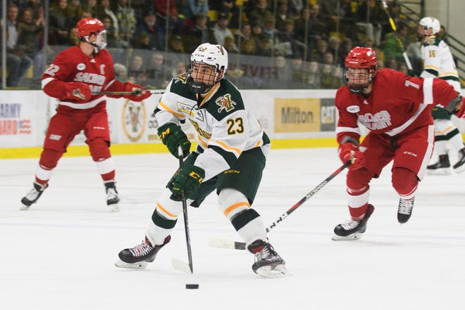 Vermont forward Max Kaufman (23) looks to shoot the puck on a breakaway during the men's hockey game between the Sacred Heart Pioneers and the Vermont Catamounts at Gutterson Fieldhouse on Jan. 4, 2019 in Burlington.