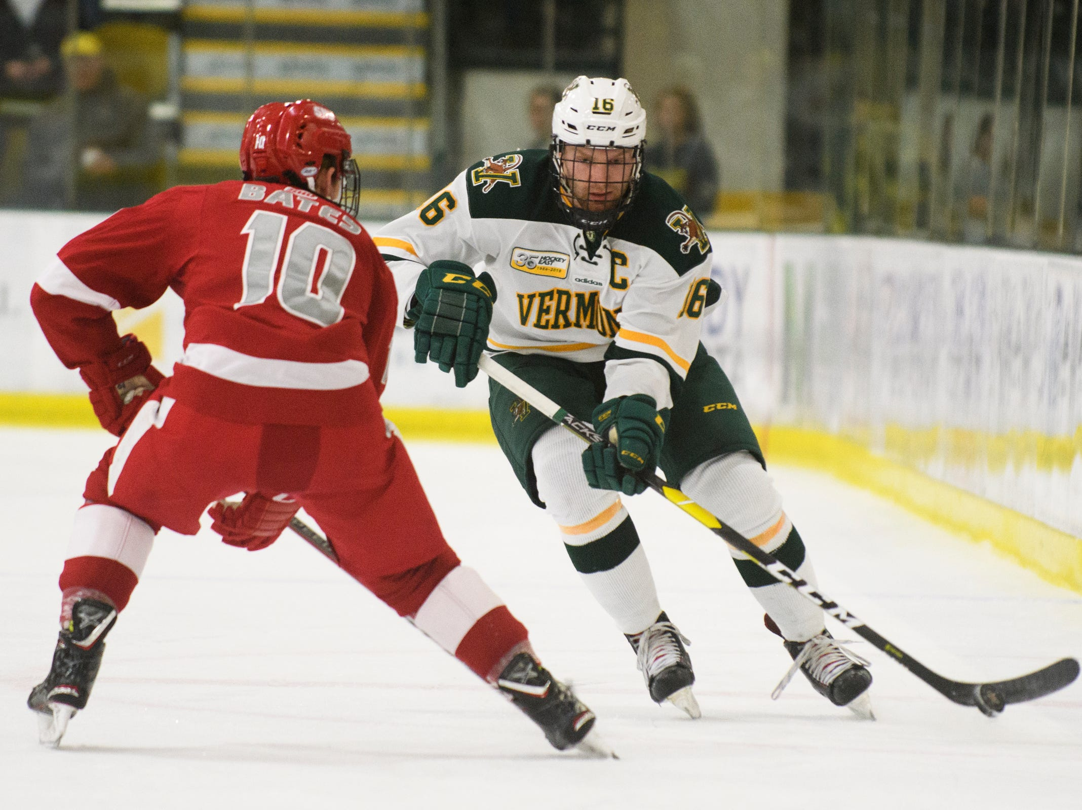 Vermont forward Derek Lodermeier (16) skates down the ice with the puck during the men's hockey game between the Sacred Heart Pioneers and the Vermont Catamounts at Gutterson Field House on Friday night January 4, 2019 in Burlington.