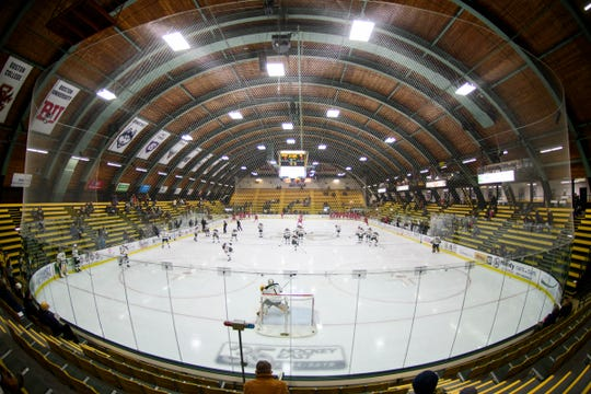 The teams warm up during the men's hockey game between the Sacred Heart Pioneers and the Vermont Catamounts at Gutterson Field House on Friday night January 4, 2019 in Burlington.