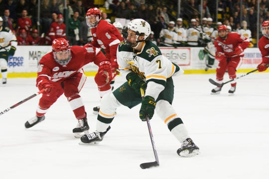 Vermont forward Liam Coughlin (7) looks to take a shot during the men's hockey game between the Sacred Heart Pioneers and the Vermont Catamounts at Gutterson Field House on Friday night January 4, 2019 in Burlington. )
