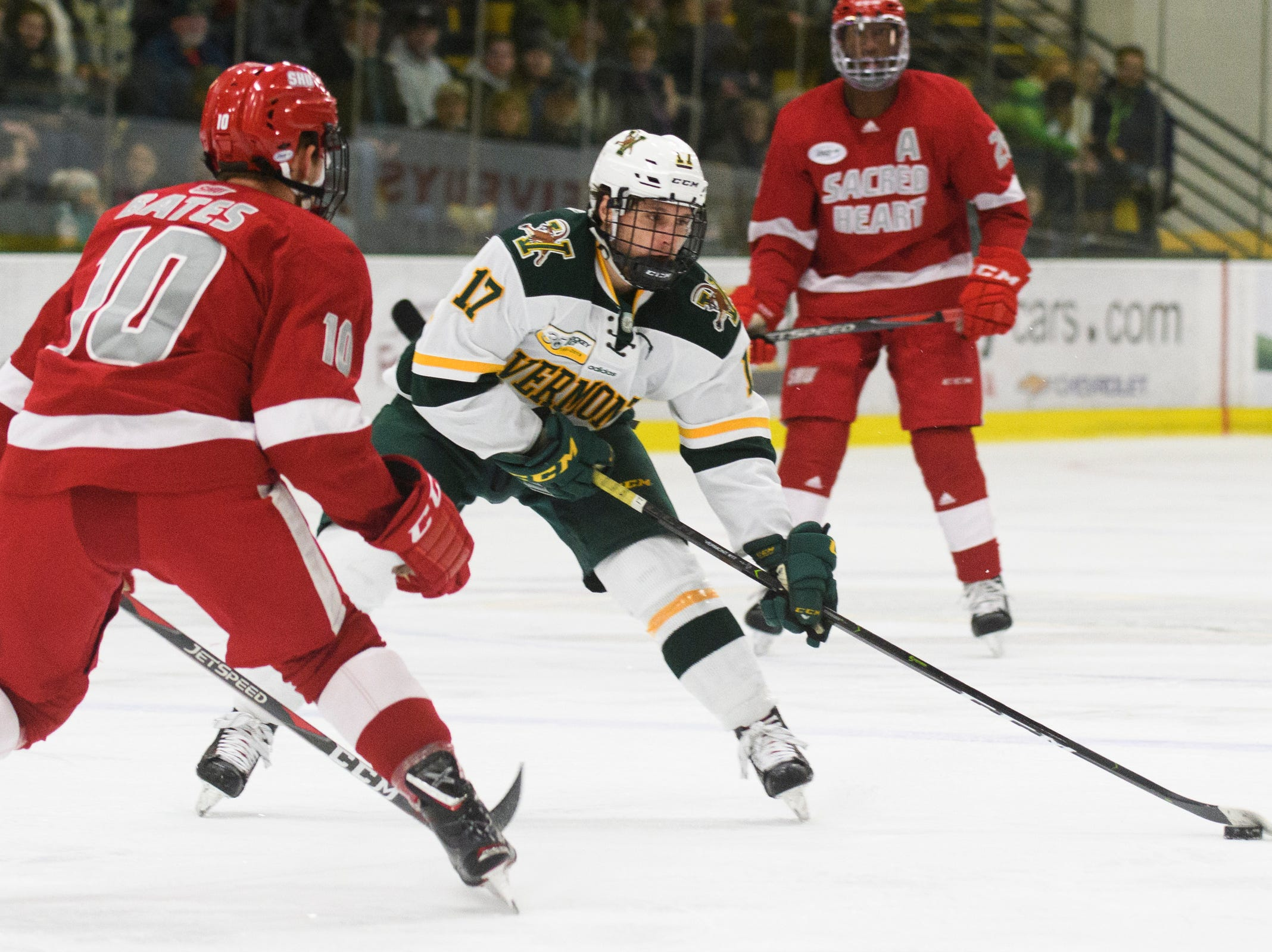 Vermont forward Craig Puffer (17) looks to shoot the puck during the men's hockey game between the Sacred Heart Pioneers and the Vermont Catamounts at Gutterson Field House on Friday night January 4, 2019 in Burlington.