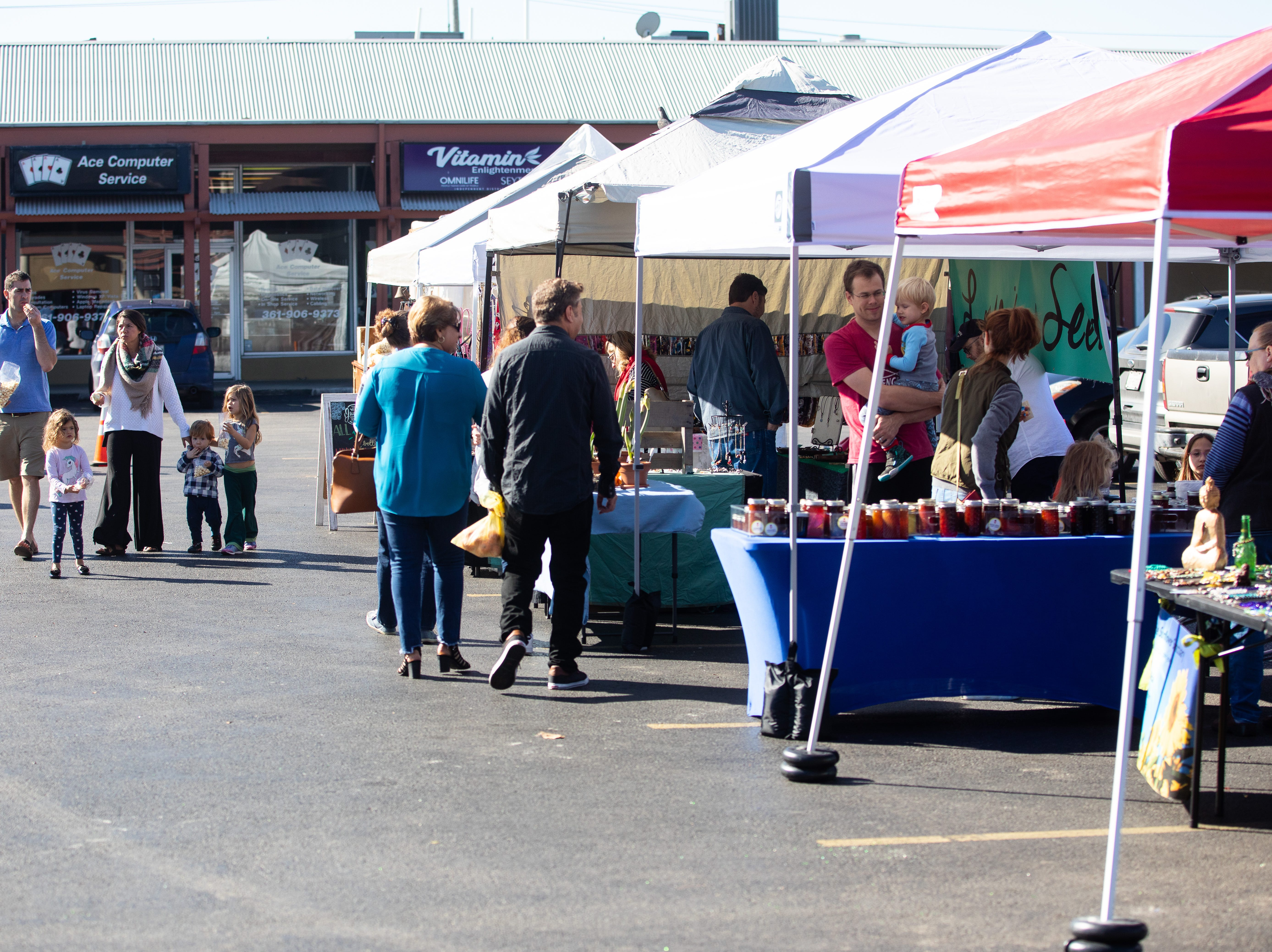 People walk thought the the Corpus Christi Southside Farmers' Market located at 5800 Everhart Road on Saturday, Jan. 5, 2019.