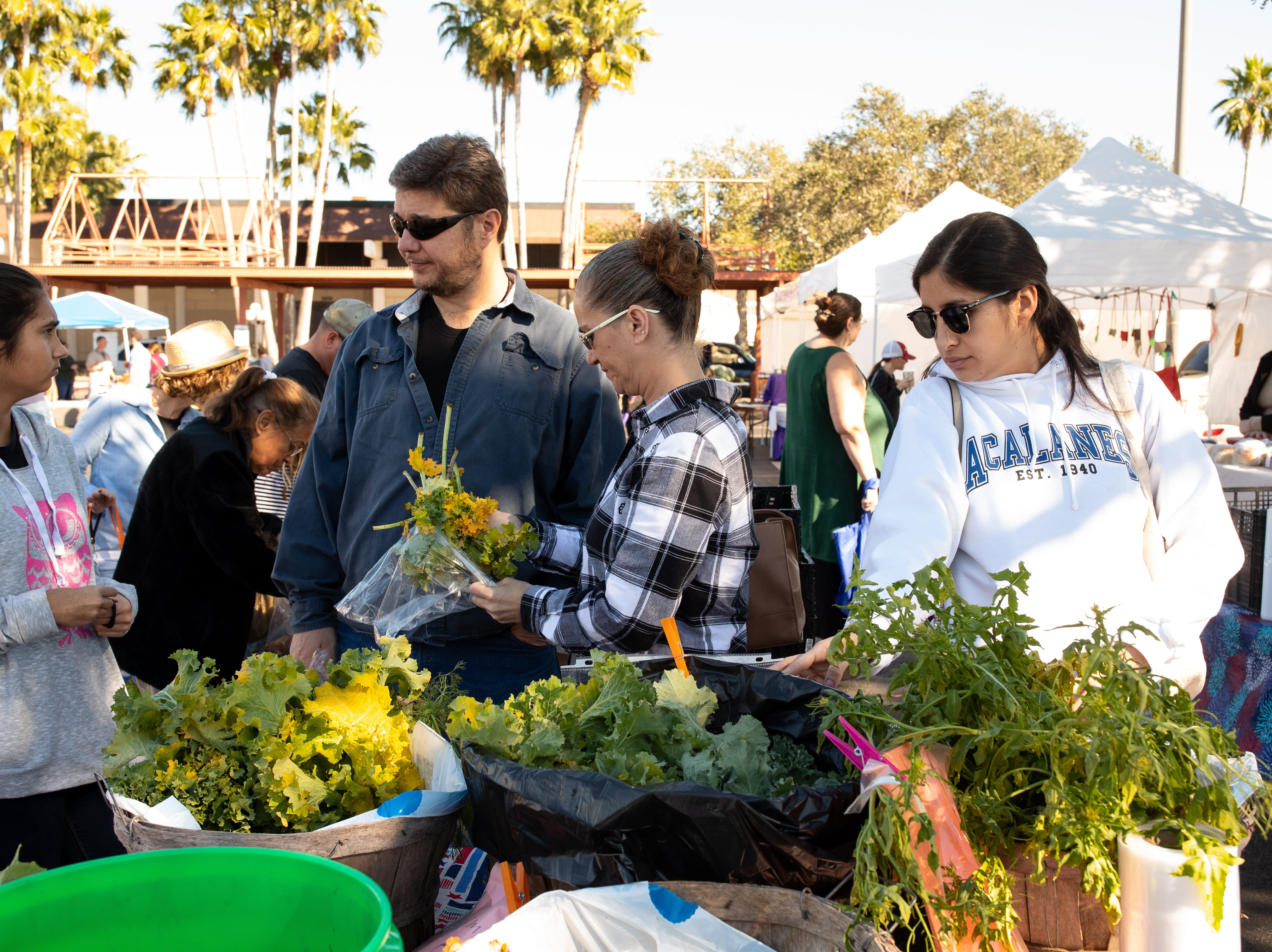 People look thought fruit and produce at the Corpus Christi Southside Farmers' Market located at 5800 Everhart Road on Saturday, Jan. 5, 2019.