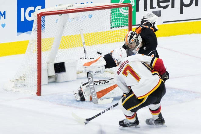TJ Brodie scored the game-winning goal just shy of two minutes into overtime to have the Calgary Flames beat the Flyers 3-2.