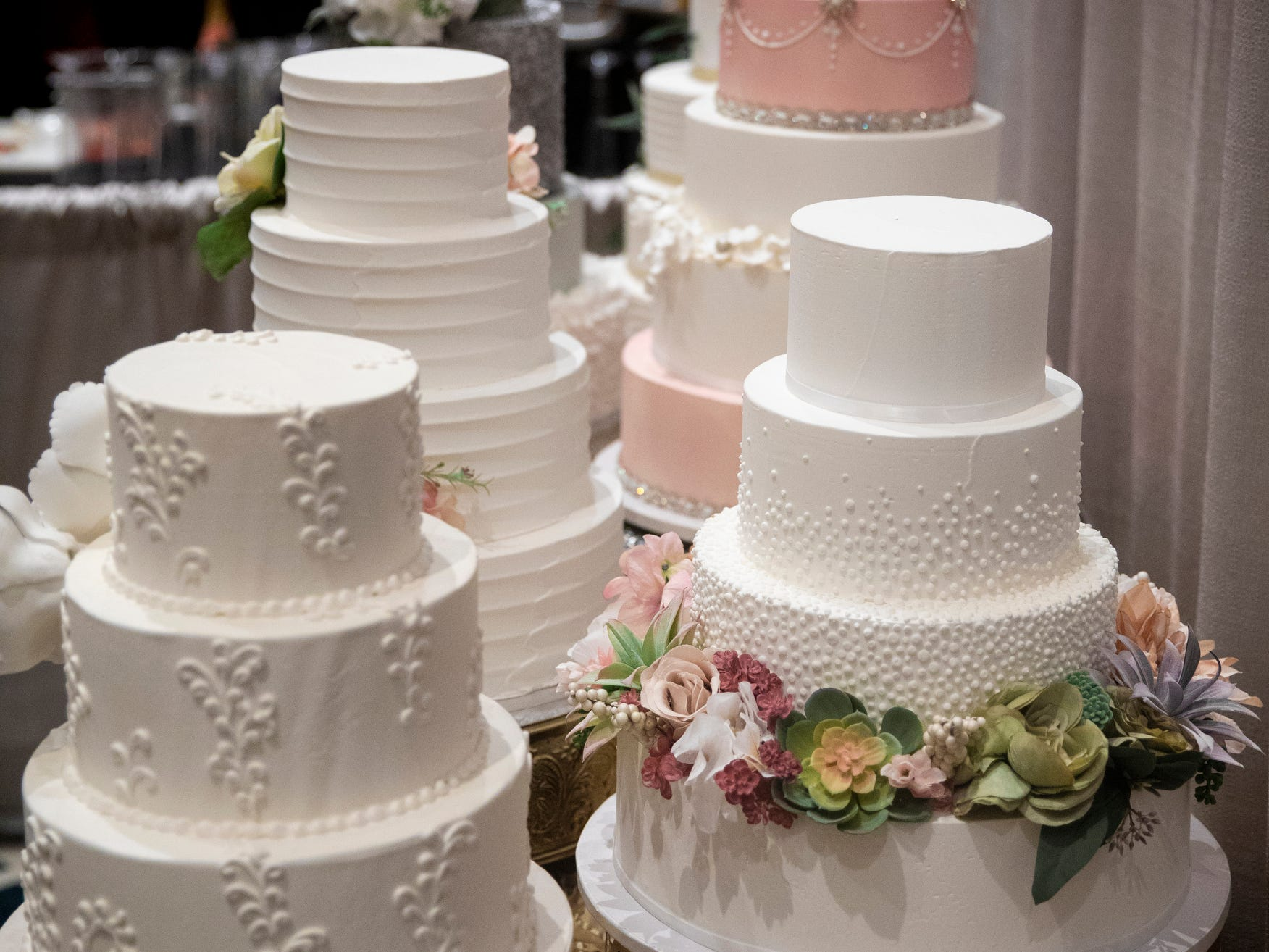 Buttercup Cake House of Covington has numerous wedding cakes on display and offers samples for the Wendy's Bridal Show at the Duke Energy Convention Center Saturday, January 5, 2019 in Downtown Cincinnati.
