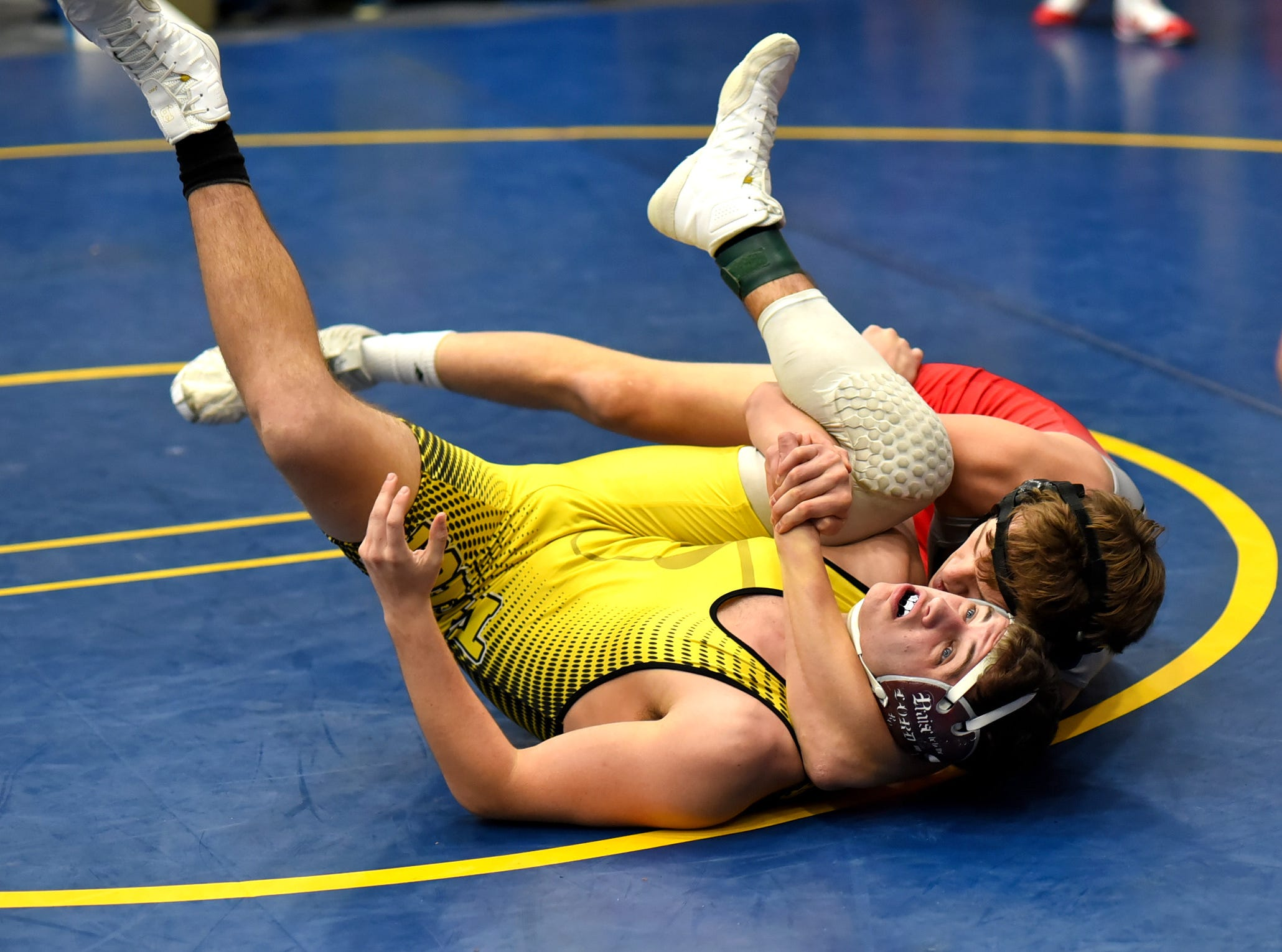 Chad Jarvis comes back for a Goshen pinfall over Dakotah Ritter of Taylor in the 170 lbs. class at the Bob Kearns Madeira Invitational, January 4, 2019.
