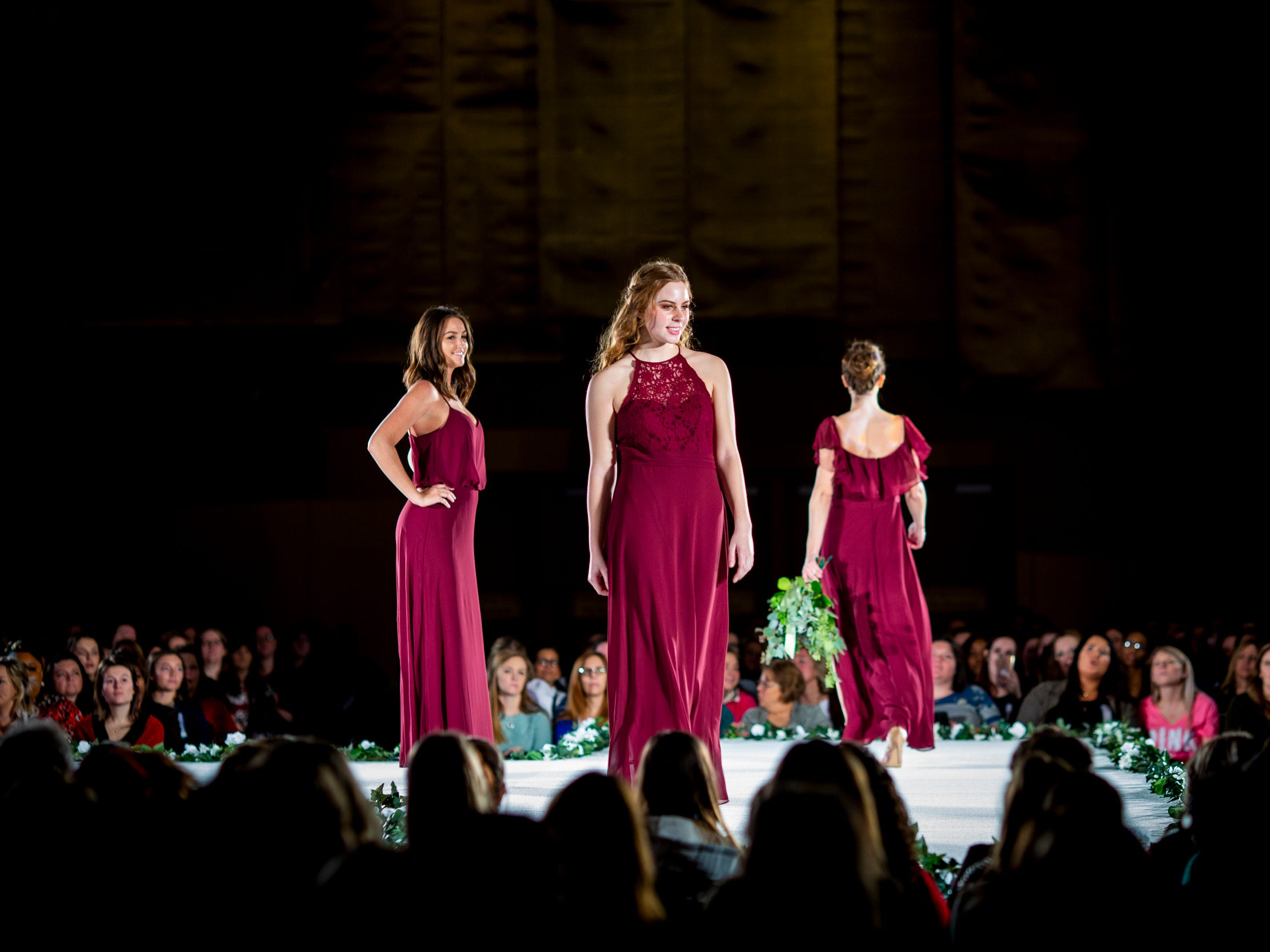 Models walk down the runway in bridesmaid dresses for the fashion show at the Wendy's Bridal Show at the Duke Energy Convention Center Saturday, January 5, 2019 in Downtown Cincinnati.