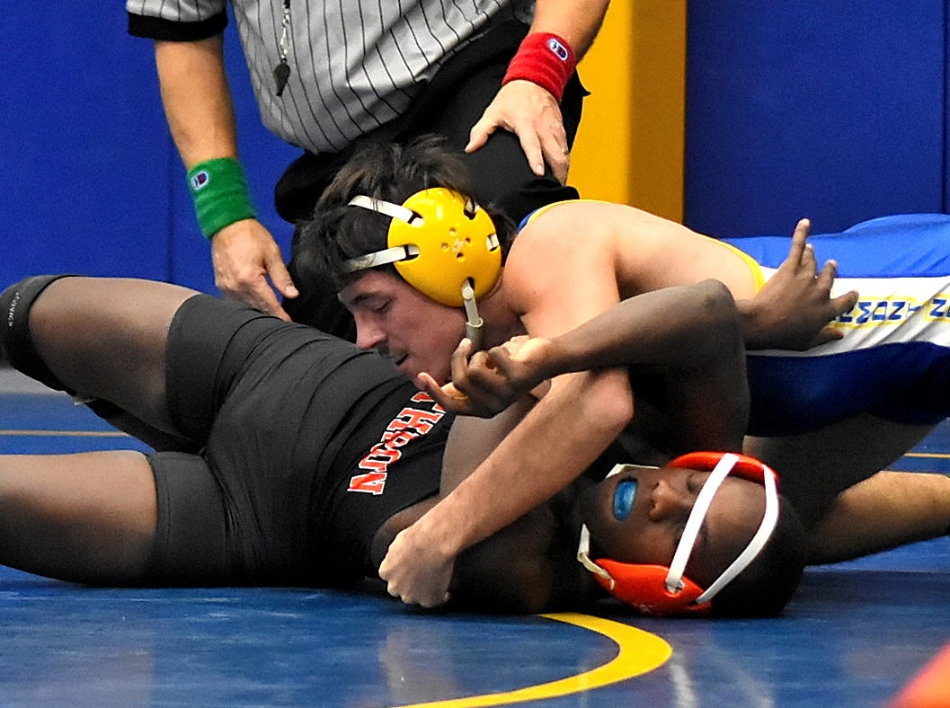 Tyler Conley of Clermont Northeastern tops Withrow's Mose Jemison in the 138 lbs. class at the Bob Kearns Madeira Invitational, January 4, 2019.