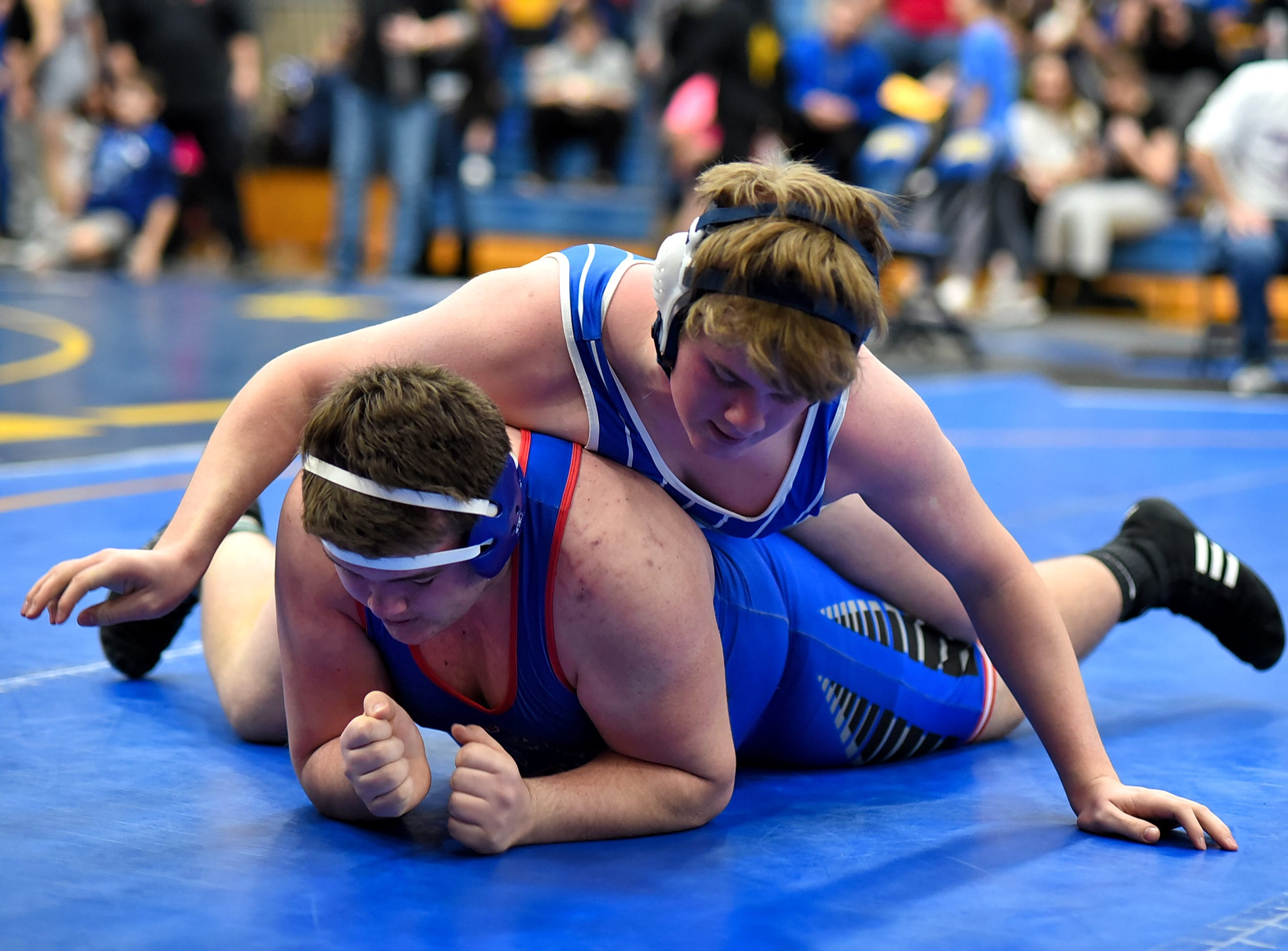 Michael Manning of Covington Catholic takes down Shawn Viessmann of Reading in 285 lbs. class first-round action at the Bob Kearns Madeira Invitational, January 4, 2019.