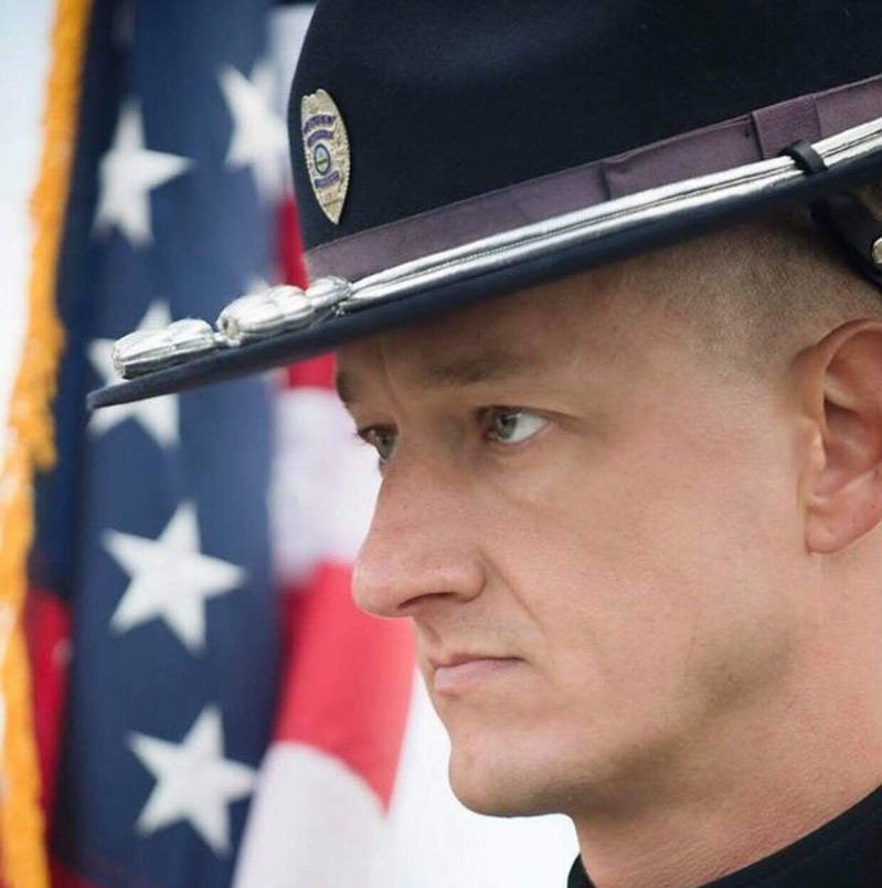 No charges in death of Colerain officer Dale Woods. Driver: 'I share their pain as well'
