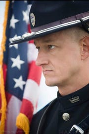 Colerain Township Police Officer Dale Woods was struck Jan. 4 while clearing a crash site and died three days later