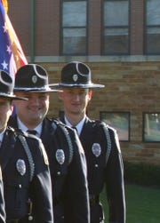 Dale Woods, a Colerain Township officer who suffered critical injuries after being struck by a truck, is seen here while serving in the Colerain Township Police Honor Guard.