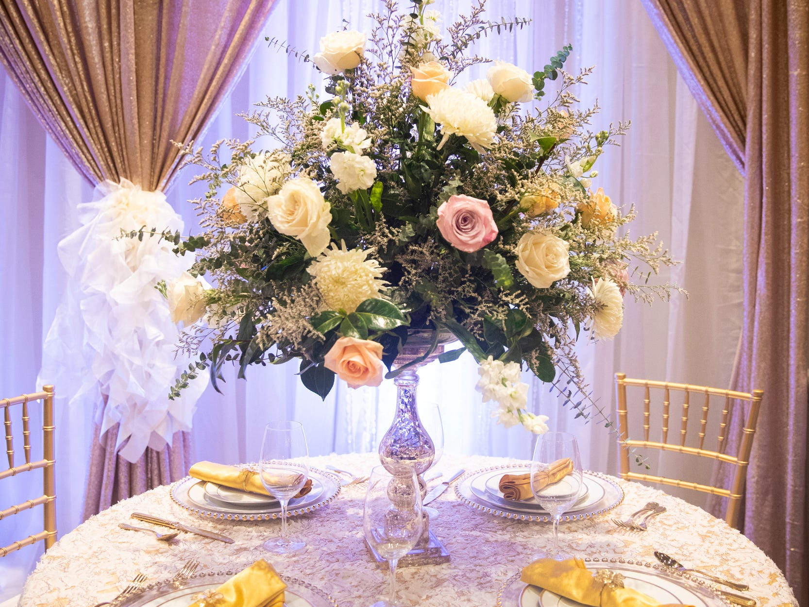 A&S Party Rental displayed various linens, table decorations, chairs and lighting at their booth at Wendy's Bridal Show at the Duke Energy Convention Center Saturday, January 5, 2019 in Downtown Cincinnati.